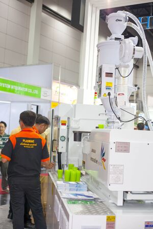 polythene: BANGKOK ,THAILAND - JULY 11: Unidentified people interesting a PET perform injection machine at InterPlas Thailand 2015 , on JULY 11, 2015 in Bangkok, Thailand. Editorial