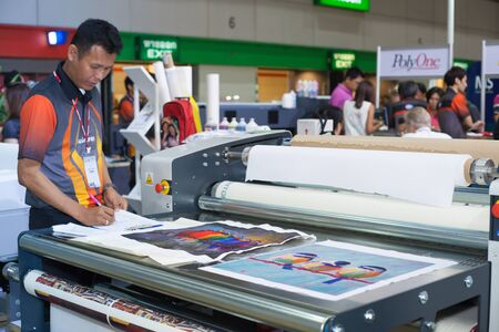 manufacturers: BANGKOK ,THAILAND - JULY 11: Unidentified people check with  digital textile printer at Garment Manufacturers Sourcing Expo  2015 (GFT 2015) , on JULY 11, 2015 in Bangkok, Thailand.