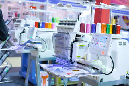 manufacturers: BANGKOK ,THAILAND - JULY 11: Textile machine with colors threads  in Garment Manufacturers Sourcing Expo 2015 (GFT 2015), on JULY  11, 2015 in Bangkok, Thailand.