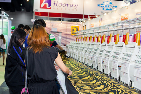 textile machine: BANGKOK ,THAILAND - JULY 11: Textile machine with colors threads  in Garment Manufacturers Sourcing Expo 2015 (GFT 2015), on JULY  11, 2015 in Bangkok, Thailand.