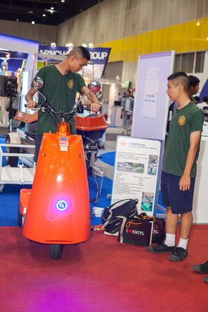three wheel: BANGKOK ,THAILAND - JULY 18: electronic three wheel scooter in  Engineering Expo 2015 , on JULY 18, 2015 in Bangkok, Thailand