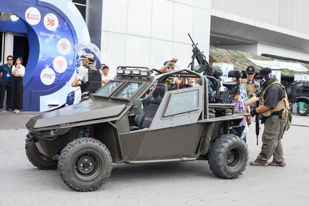 cross armed: BANGKOK ,THAILAND - JULY 18: Unidentified actor show action with  light armored vehicle in Engineering Expo 2015 , on JULY 18, 2015  in Bangkok, Thailand.