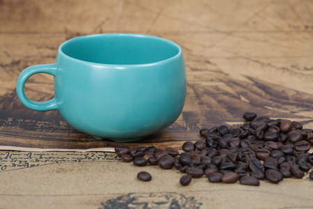 ancient map: cup of coffee and bean lies on an ancient map