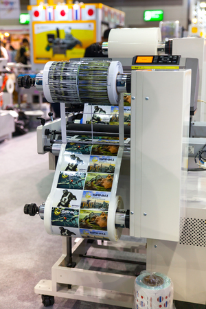 guillotine: BANGKOK - AUGUST 29 :Coating and cutting small machines at Pack  Print and T-PLAS THAILAND on Aug 29,2015 in BITEC ,Bangkok,  Thailand. Editorial