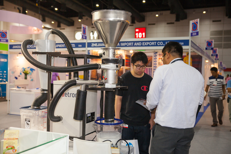 sort out: BANGKOK - AUGUST 29 :Unidentified people interesting with sort out polymer resins tool at Pack Print and T-PLAS THAILAND on Aug 29,2015 in BITEC ,Bangkok, Thailand.