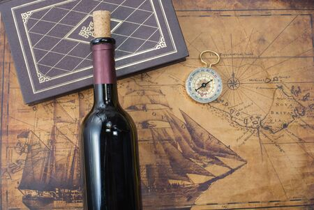 uncork: bottle of wine  on the background of old maps Stock Photo