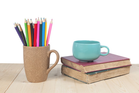 color pencils, coffee cup on wooden table