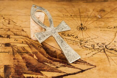 cross: old cross on old map background