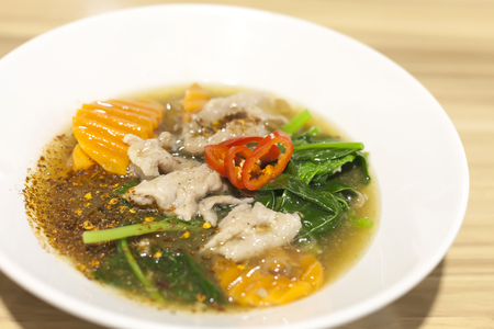 soaked: Fried noodle with pork and kale soaked in gravy soup
