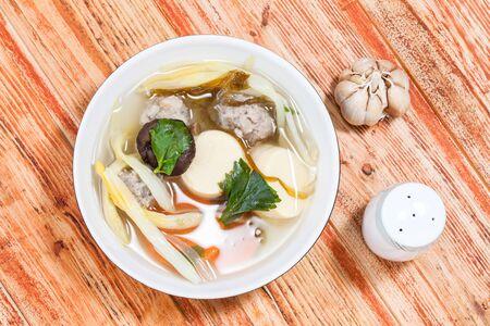 seasoned: Mildly seasoned soup that Consisting of pork, tofu,  carrots,