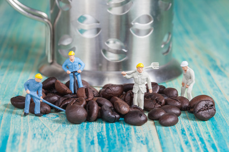 miniature people: Miniature people working with coffee ,selective focus