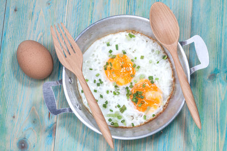 eggs: Egg in pan on wood table Stock Photo