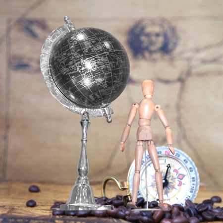 proportions of man: Wooden figure and globe ball on background