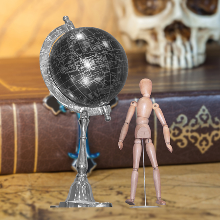 wooden figure: Wooden figure and globe ball on background