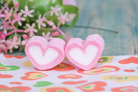 romantic date: Valentine candies on color wood.selective focus.