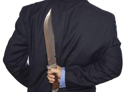 treacherous: Knife hidden behind the businessman Stock Photo