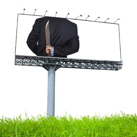 treacherous: Knife hidden behind the businessman on billboard  advertising Stock Photo