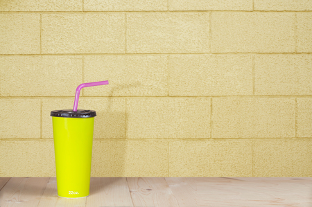 non alcoholic beverage: minimalism, cardboard cup with a straw. Stock Photo
