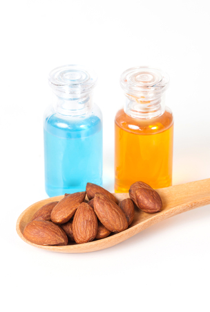 hard core: Almonds on wood and oil bottle