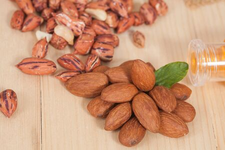 toughness: Almonds  on wooden background