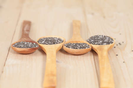 flavorings: Nutritious chia seeds on a wooden spoon