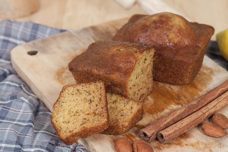 homemade cake: Homemade banana bread sliced on a table . rustic style Stock Photo