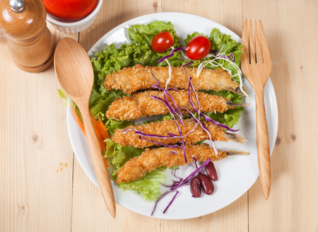 fish fry: Fish fry in plate on wood desk