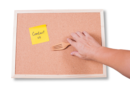 move ahead: Contact us.written on an yellow sticky note