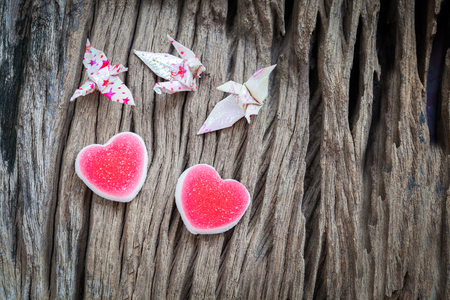 placidity: Origami couple paper crane and heart Stock Photo