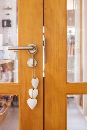 room door: Wooden door with heart in shop room Stock Photo