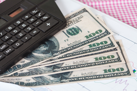 demographics: Business accounting concept. calculator and US  dollar Stock Photo