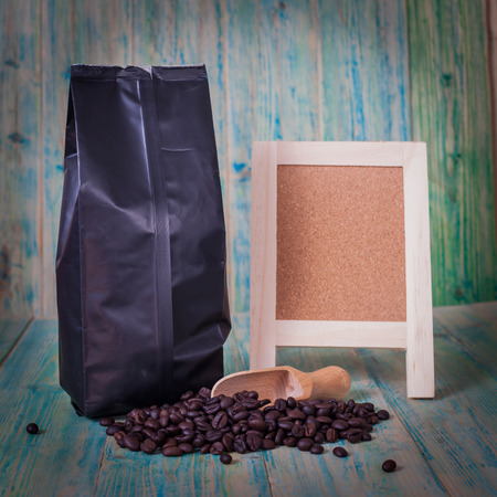 cheerfulness: package of coffee beans and menu board on the wooden  table