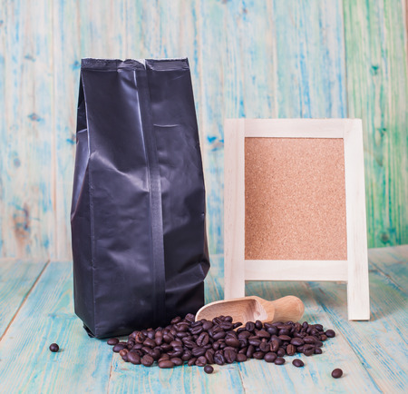 joyfulness: package of coffee beans and menu board on the wooden  table