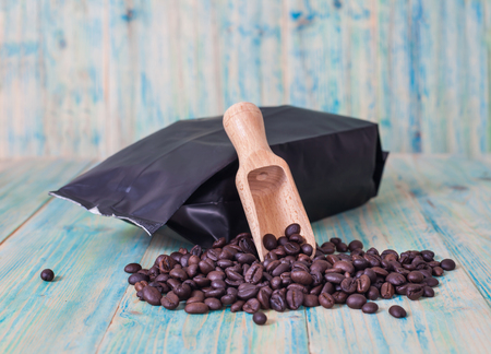 cheerfulness: package of coffee beans on the wooden table