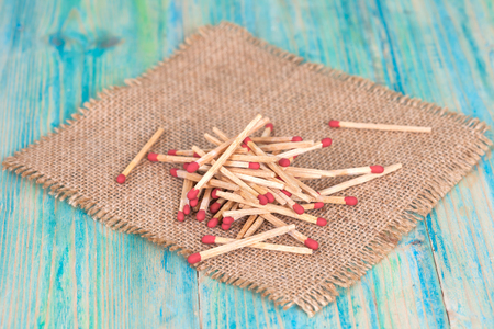 friction: Matchsticks over wooden background Stock Photo