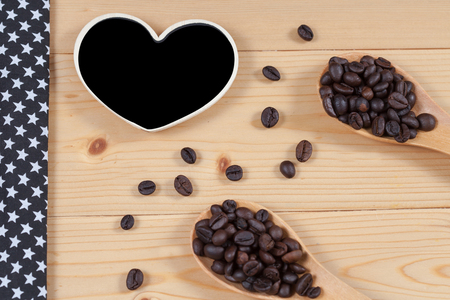 espreso: strong roasted coffee beans on grunge  wood background
