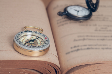 leading education: Compass on open old book