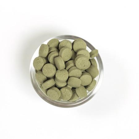 alternative living: Herbal pill in bowl.