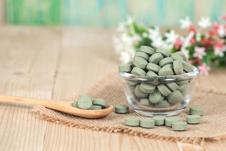 alternative living: Herbal pill on bowl. herb for healthy living.