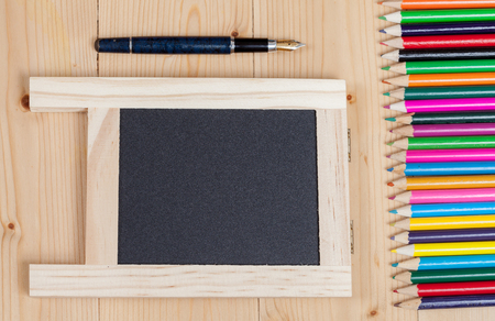 Colored pencils on a wooden Stock Photo