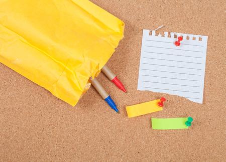 pin board: pin on memo paper on cork board