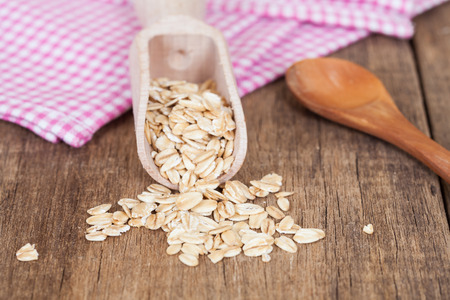 oats in spoon on wood table Stock Photo