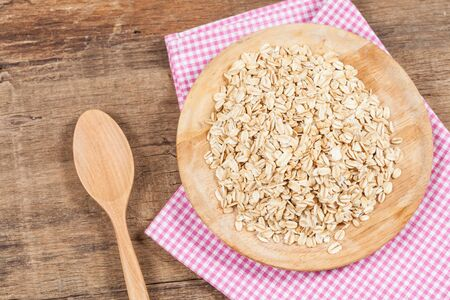 wild oats: oats in plate on wood table