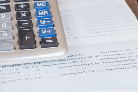 bank activities: calculator on book bank