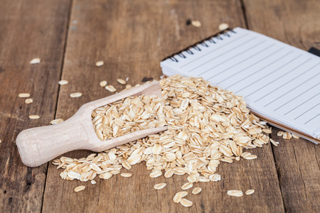wild oats: oats in spoon on wood table Stock Photo