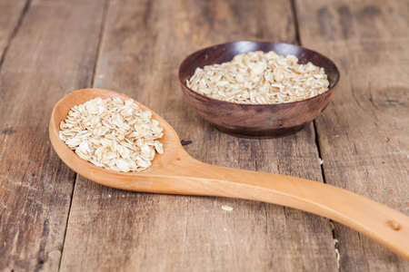 oats in spoon on wood tabl Stock Photo