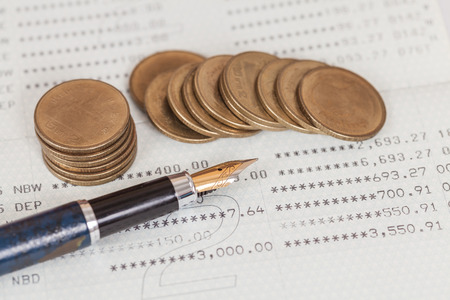 calculator chinese: coins money on book bank Stock Photo