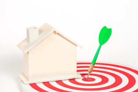 Miniature house on dart board