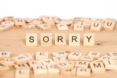 Sorry ,word written on wood cube