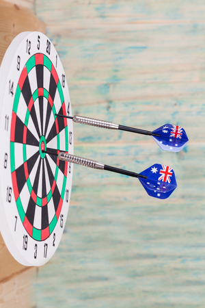 projectile: Darts arrow with Australia flags on red dart board